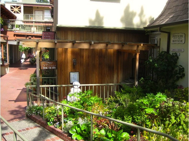 Carmel plaza charming specialty shopping in a garden for Flying fish bar and grill
