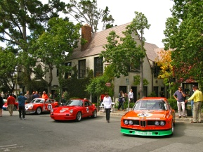 Cars are displayed in front of the backdrop of Carmel's architecture